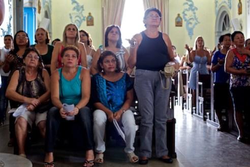 March 2011. Ladies at prayer inside Nossa Senhora da Penha Church, Rio de Janeiro.