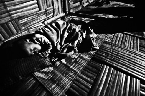 A young Ollo Tribe boy sleeping on the floor of a house made of Bamboo. The tribe is spread across Myanmar and India. Few of them migrated from there and settled in regions across the Southern and Eastern part of Arunachal Pradesh.
