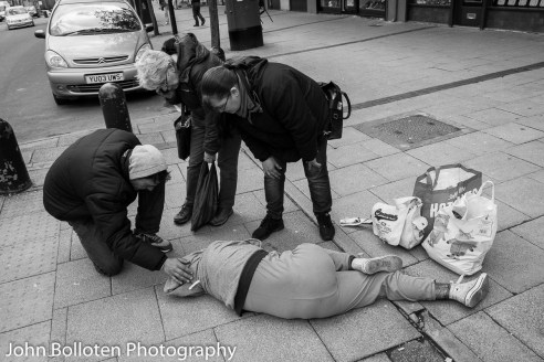 A young woman collapses on the pavement by the market after smoking spice. An ambulance appeared soon after and medical staff saved her life