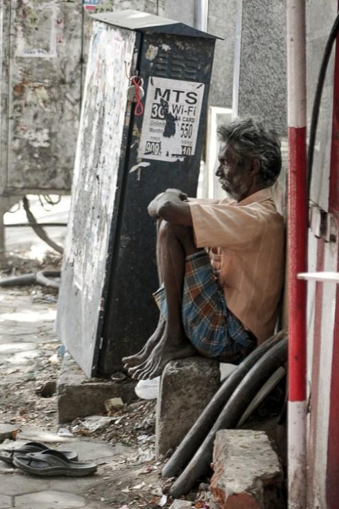 Man resting awkwardly Chennai, India