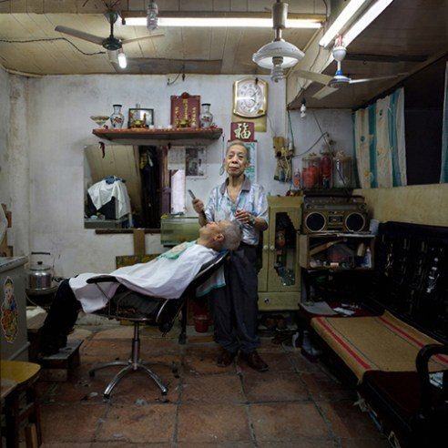 Rong'an Guo, a barber. He began to learn haircut at 15. He said he just wanted to be a barber for a lifetime.