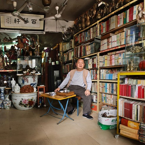 Mr. Huang, an old books store owner. He said the development of the city was too fast, old books made him feel calm.