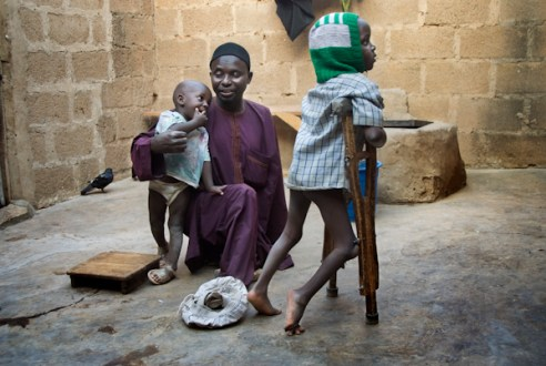 Aminu Ahmed Tudun-Wada, chairman of KPVTA, with two of his children at his home in Kano. Umar (R) is his only child affected by polio. Umar was born in 2003 when immunization was boycotted in the State of Kano and its surroundings; he contracted polio few months after his birth. Kano, Nigeria
