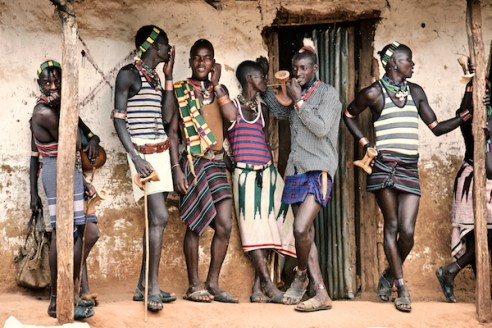 The Boys In Town The tribes have many similarities but they also have distinctive differences. Young men of the Hamar tribe, for example, have to jump a number of bulls to 'come of age', while the Suri and Mursi tribes compete through stick fighting.