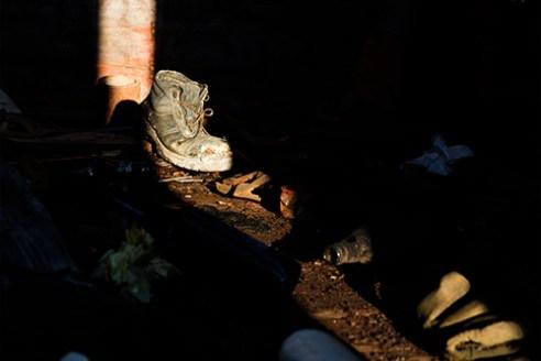 Shoe inside a wagon of an abandoned Train. Thiva, Greece.