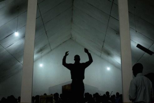 A conductor leads a choir at the Mzuzu Pentecostal Church in the town of Mzuzu, Malawi's third largest city.