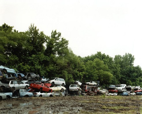 Piled cars, ready for final sale 2003