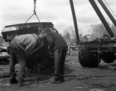 Bob and son Bobby removing a part for sale, 1998