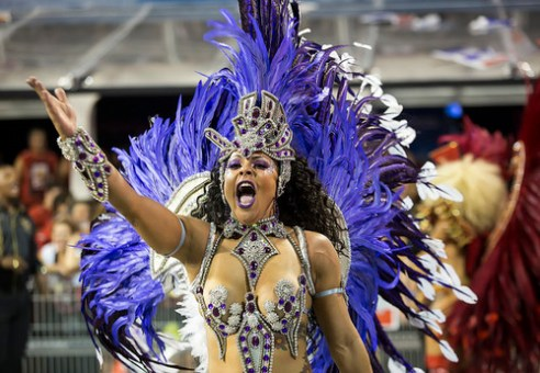 "São Paulo, Brazil- February 7, 2016: Brazilian samba dancer or ""Muse"" performing in costume for the samba school Vai Vai at the Amhembi Sambadrome in Sao Paulo."