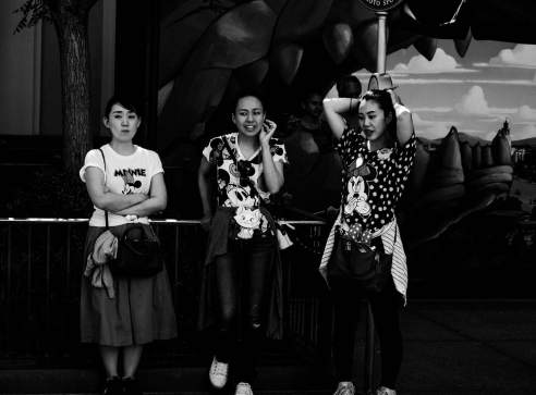 Three Asian women at Disneyland's California Adventure