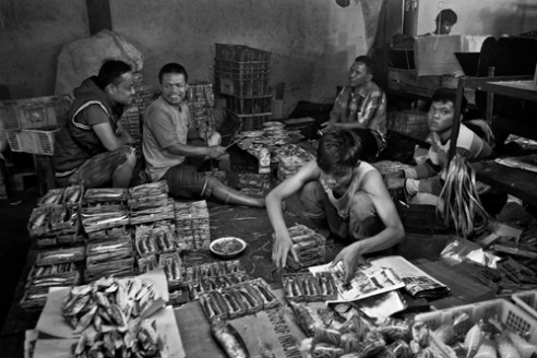 Traditional market activity at night, open until morning. Pasar Kramat Jati. East Jakarta. Indonesia
