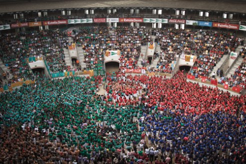 Castellers de Barcelona crown their human tower during the XXV Concurs de Castells in Tarragona