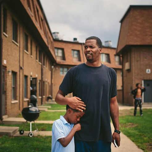 East Chicago, Indiana Lamont Anderson embraces his son Lamont Anderson Jr., 8, at the West Calumet Housing Complex. Anderson Jr.'s blood lead levels test results were above the CDCís 5 mg/d threshold for action. After living in the complex for more than a decade, the family moved to Gary, Indiana earlier this summer
