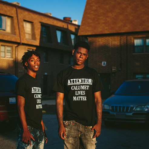"""East Chicago, Indiana 18-year-old brothers Antwon Jones, at left, and D. Jones pose for a portrait near their home in the West Calumet Housing Complex. """"This is where we hang out every day. We are still here with the lead,"""" D. Jones said. Though city officials learned the extent of lead and arsenic levels in the soil in late May, very few residents have moved out as of the first week of October. Many say it has been hard to find an equivalent home in the area."""