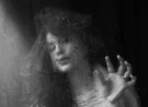 Dark and expressive fine art photography by Maren Klemp. Abstract image of ghostlike faces. emerging artist,