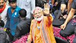 Narendra Modi waves after winning 2019 elections in India.