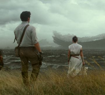 Finn, Poe, and Rey stand before the wreckage of the Death Star