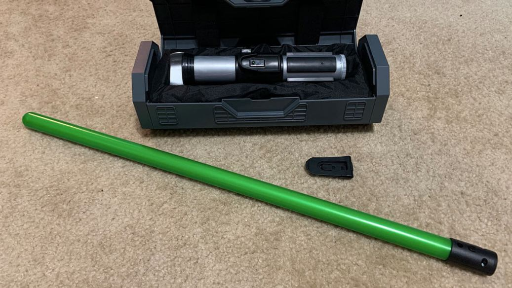 Green lightsaber blade with Yoda's hilt display in a case