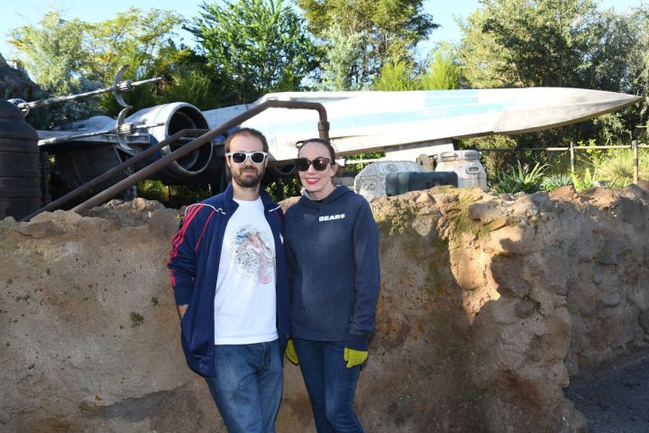 Adam & Lindsey in front of the X-Wing at Galaxy's Edge in Florida