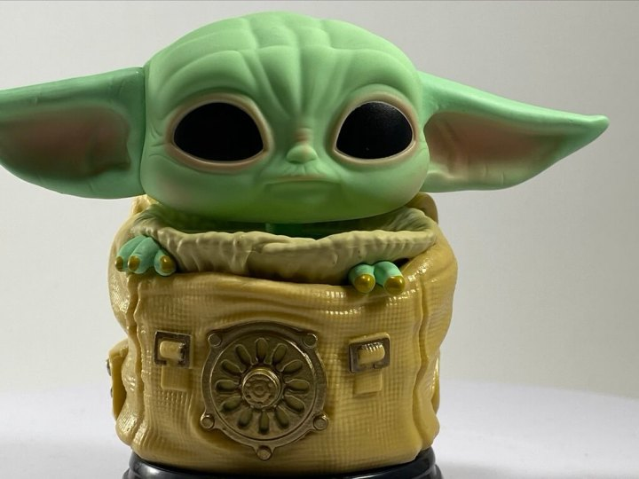NEW The Child Funko POP! feature Baby Yoda in a pouch.