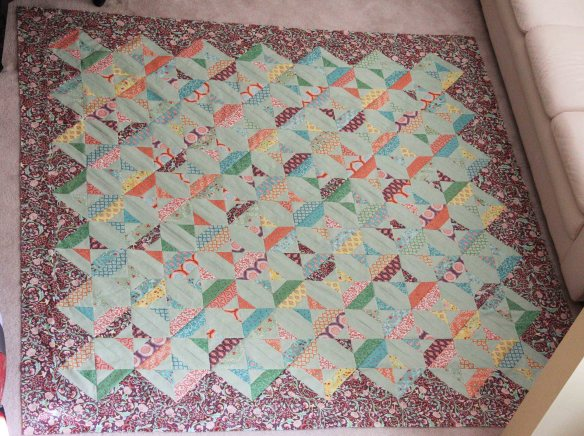 Larger than queen size. finally assembled and ready to be hand-quilted.