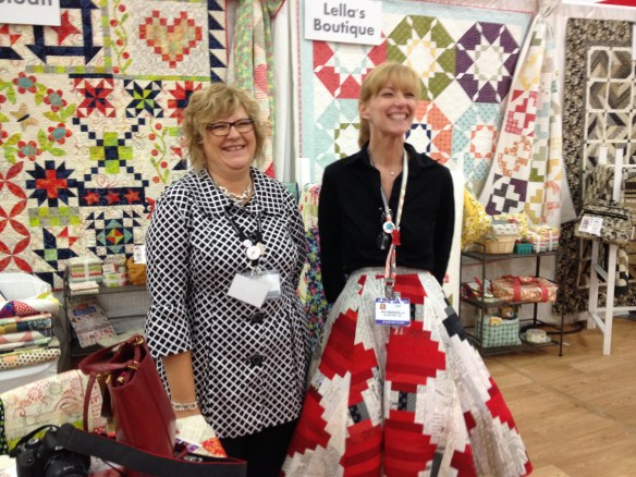 Designer Pat Sloan alongside and Aurifil rep who made a log cabin quilt and cut it up into her skirt!