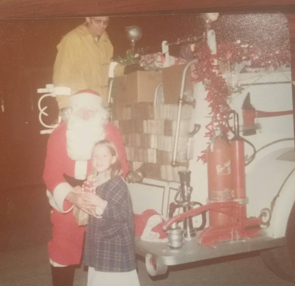 My little sister Wendy, Santa and I think it is Bob Gord on the back of the truck. From Caryn Wittig Thomas.