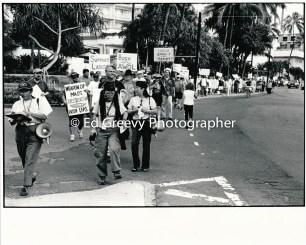 Anti war activist and union leader Claire Shimabukuro leads an anti war protest demo into Waikiki. 9123-2-24 2005