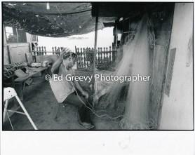 Sand Island fisherman repairing nets 4090-2-28 11-10-79