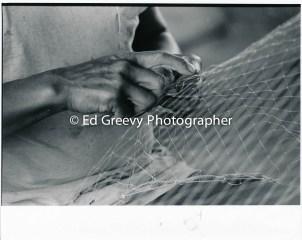 Sand Island resident repairing his nets 4090-3-13 11-10-79