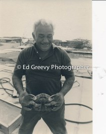 Sand Island resident. Clement Apollo with crab 4091-1-12 11-11-79