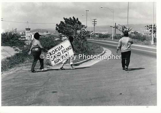 Sand Island residents with sign 4092-2-6A 11-17-79