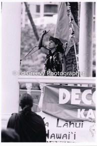 Haunani-Kay Trask speaks at Iolani Palace overthrow protes demo. %22I am not American, I am Hawaiian%22. 7085-14 1-17-93