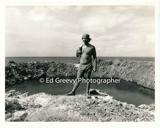 Hawaiian student stands in front of crater from the mock nuclear explosin from the ʻ60ʻs on Kaho olawe 5013 10-80 _