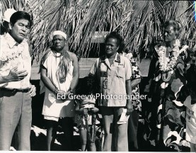 Governor George Ariyoshi speaks at Mokauea Island danoe dedication. Resident Ethel Kilaulani at center. 4049-1-6 4-7-79