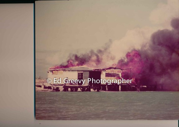 Mokauea Island house set afire by private contractor hired by the State of Hawaii, Dept. of Transportation Director, E. Alvey Wright. 1975