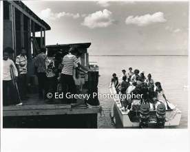 Students arrive for a tour of Mokauea Island. C1979