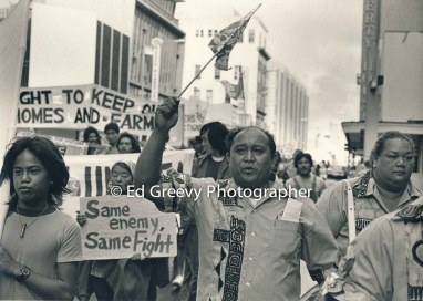mokauwa-island-resident-alehandro-romo-marches-with-sets-okubo-in-stop-all-evictions-protest-march-through-downtown-honolulu-2950-3-25a-2-14-76