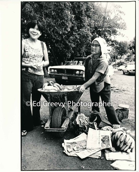 uh-ethnic-studies-student-with-mrs-matayoshi-with-her-roadside-fruit-stand-wheel-barrow-2730-1-35-8-16-74