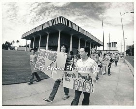 waiahole-waikane-leader-bob-fernandez-rt-leads-residents-and-supporters-in-a-protest-march-against-evictions-2932-4-35-12-4-75