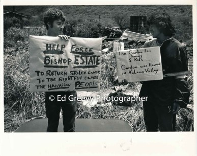 RCP leader Gene Parker holds sign with Aki. Kalama Valley 1971