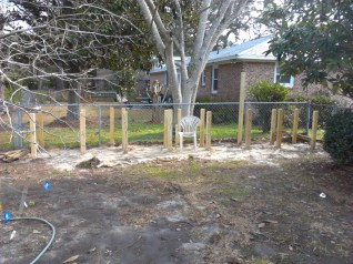 A custom keyhole raised bed garden coming to life!