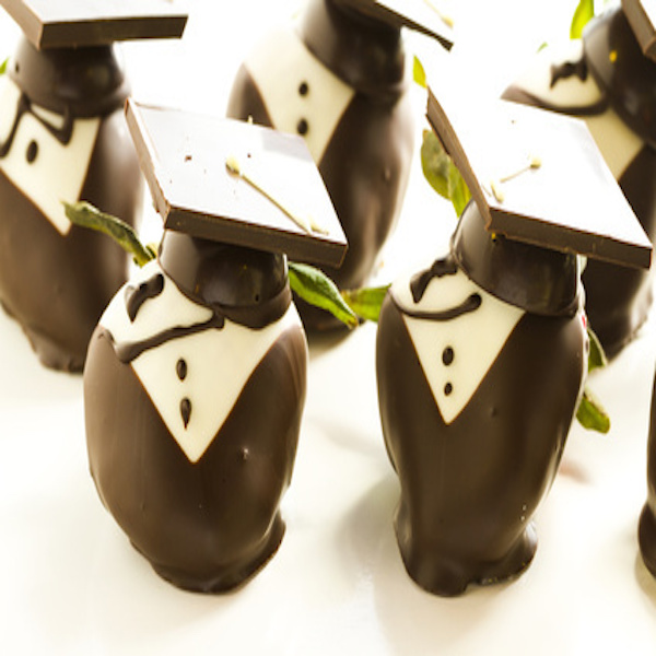 Gourmet chocolate covered strawberries decorated for graduation party.