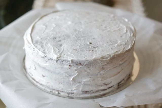 Cake frosted with crumb coat.