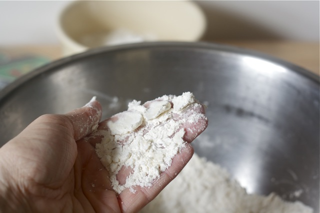 Butter rubbed into flour for buttermilk biscuits.