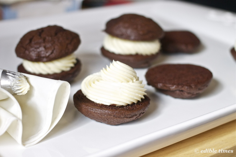 Chocolate whoopie pie with filling on plate.