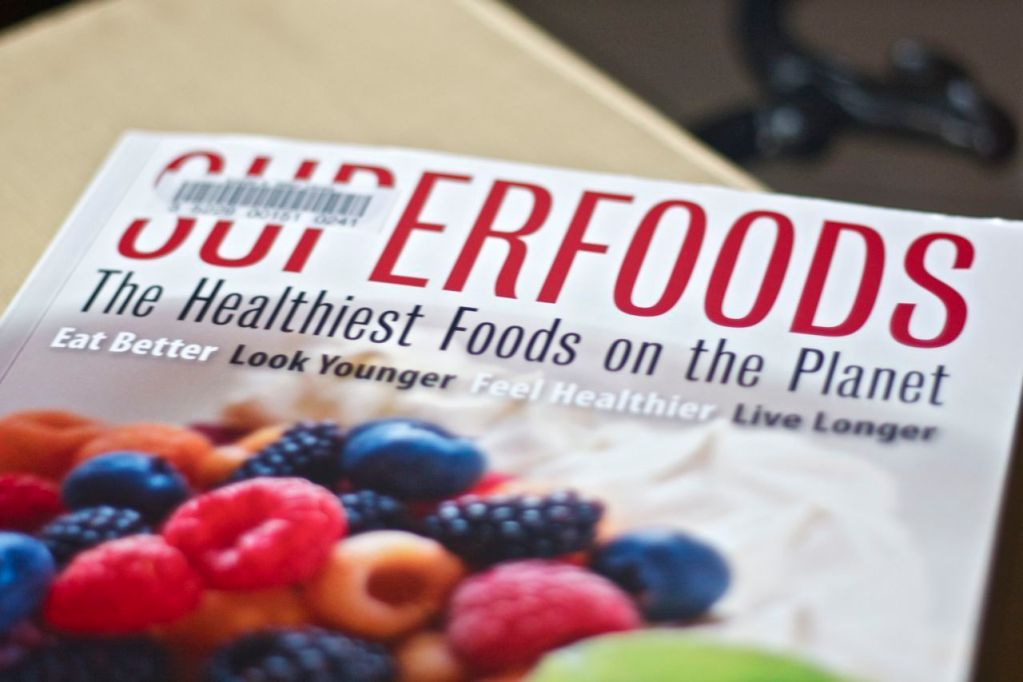 Superfoods book on table.