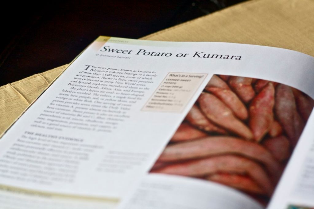 Superfoods book open to Sweet Potato page.