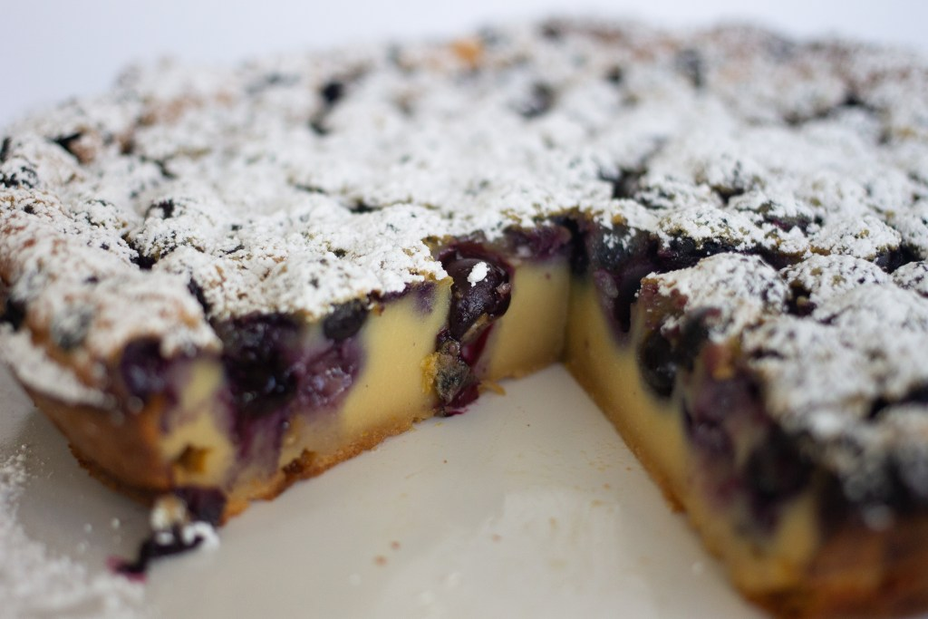 Clafoutis with slice cut out on edibletimes.com