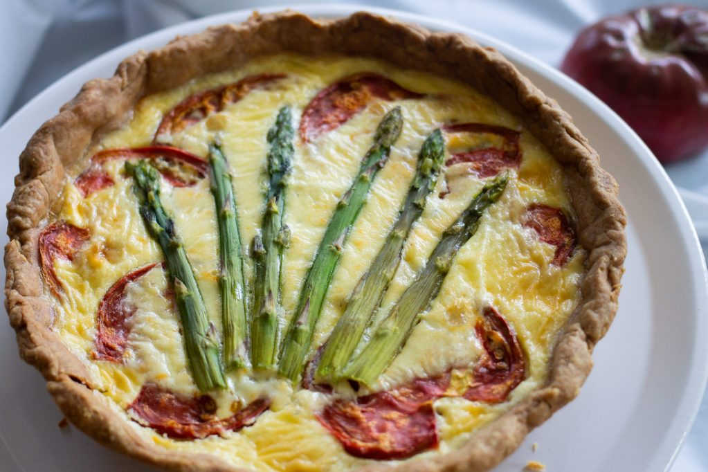 Tomato and asparagus quiche one plate.